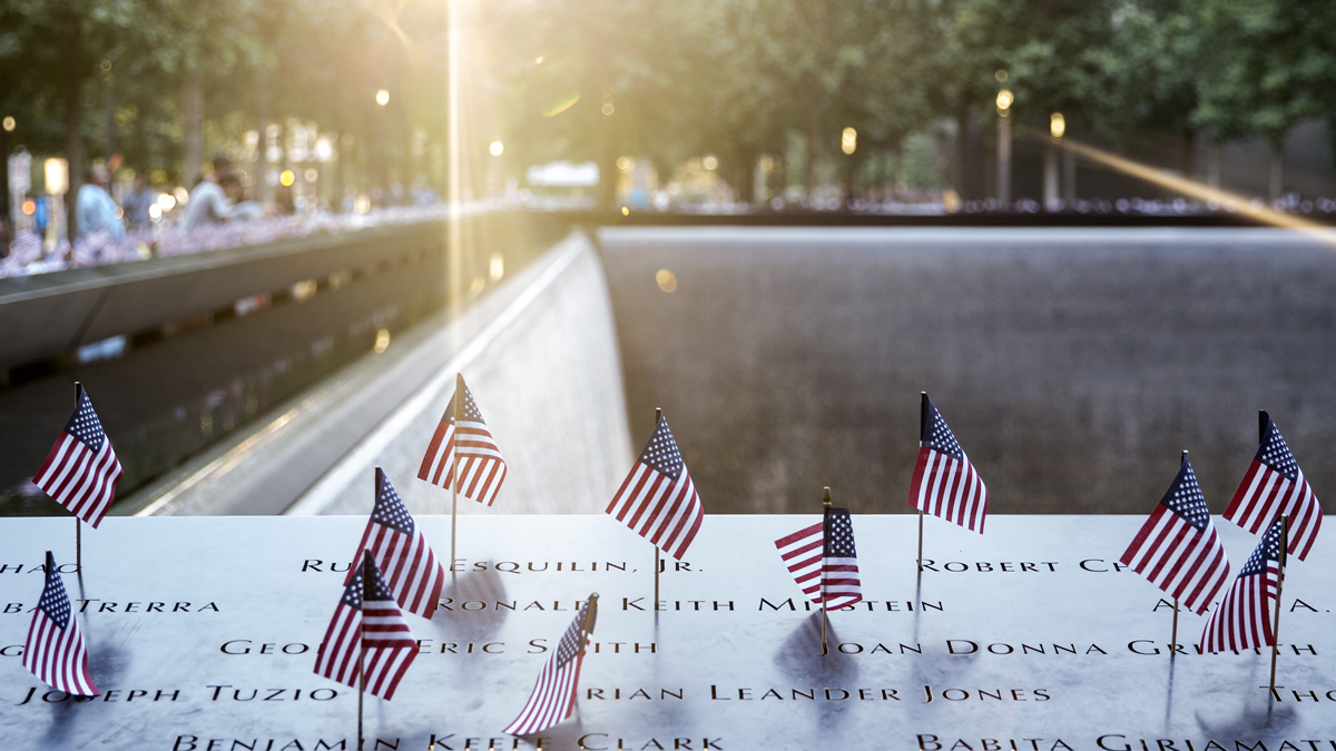 This July 4, 2018, file photo shows American flags placed in the names on the 9/11 Memorial in Manhattan.