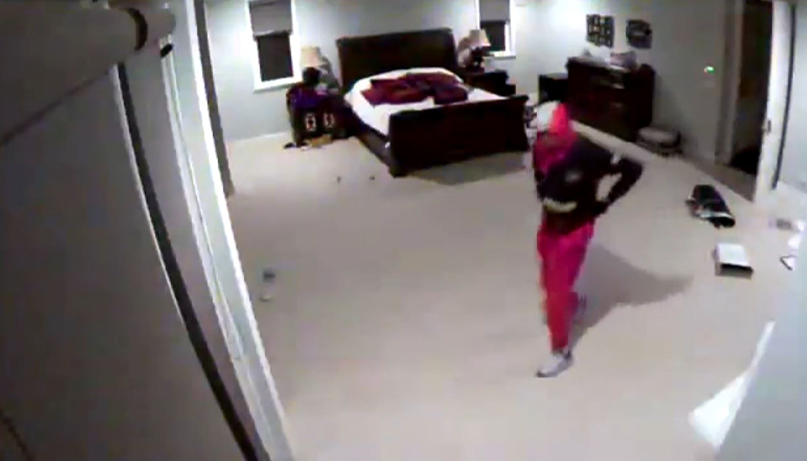 Thieves can be seen on security camera video ransacking a second-floor bedroom at the San Fernando Valley home of Yasiel Puig before they dragged a safe from the home in a burglary Sept. 18, 2018.