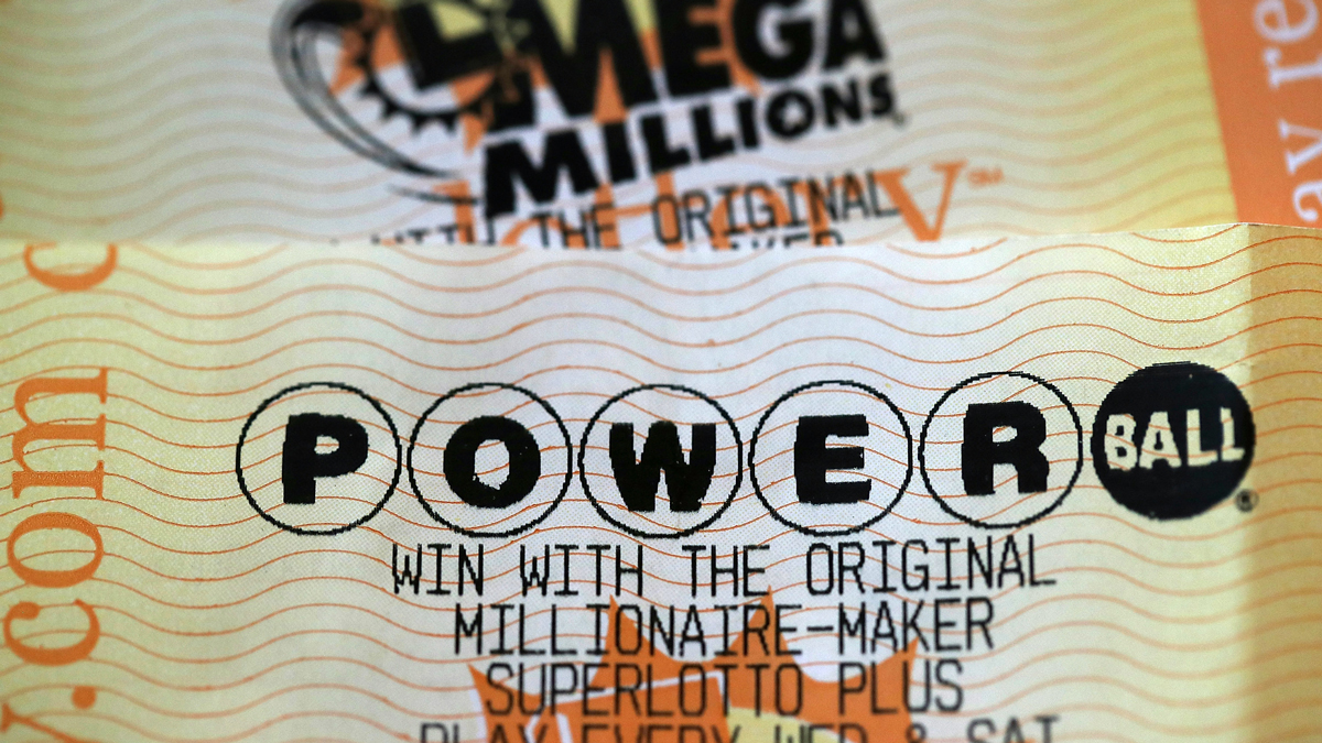 This Jan. 3, 2018, file photo shows Powerball and Mega Millions lottery tickets in San Anselmo, California.