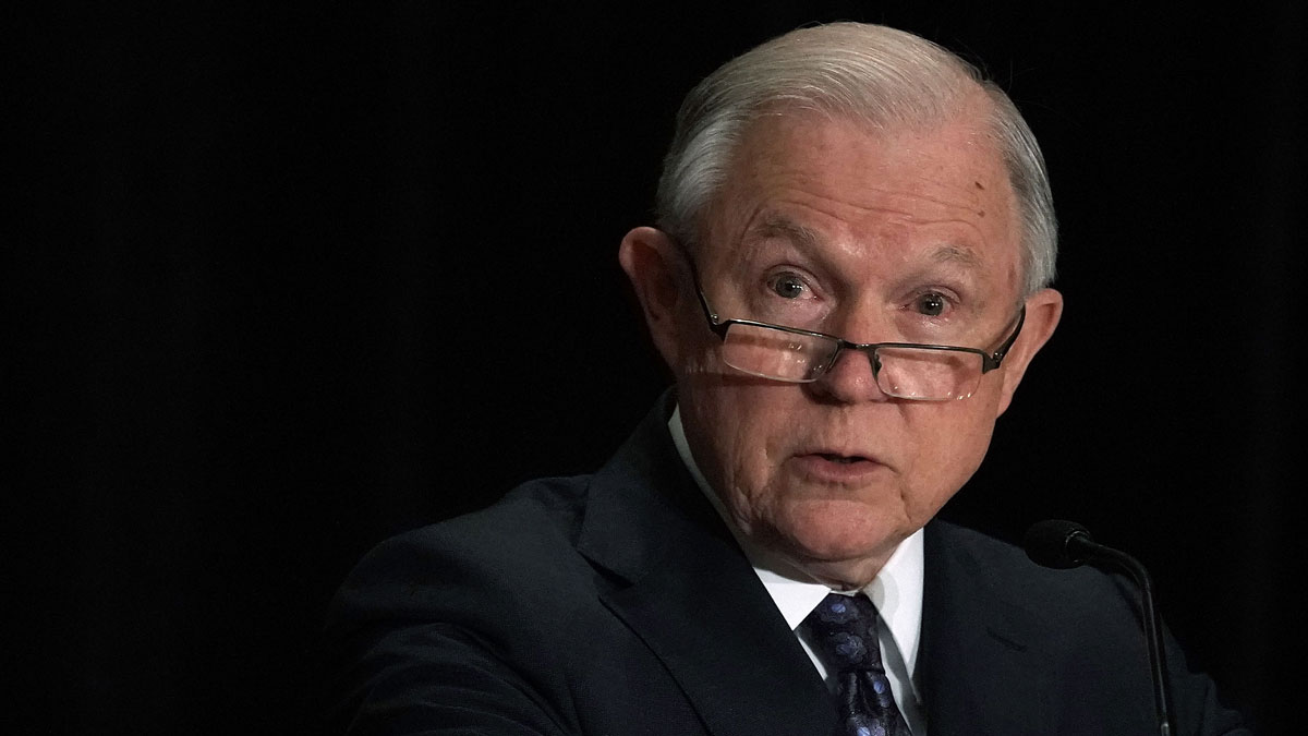This June 11, 2018, file photo shows then-Attorney General Jeff Sessions deliver remarks at a Justice Department legal training event in Tysons, Virginia. Sessions spoke on his intention to limit reasons for people to claim asylum in the U.S.