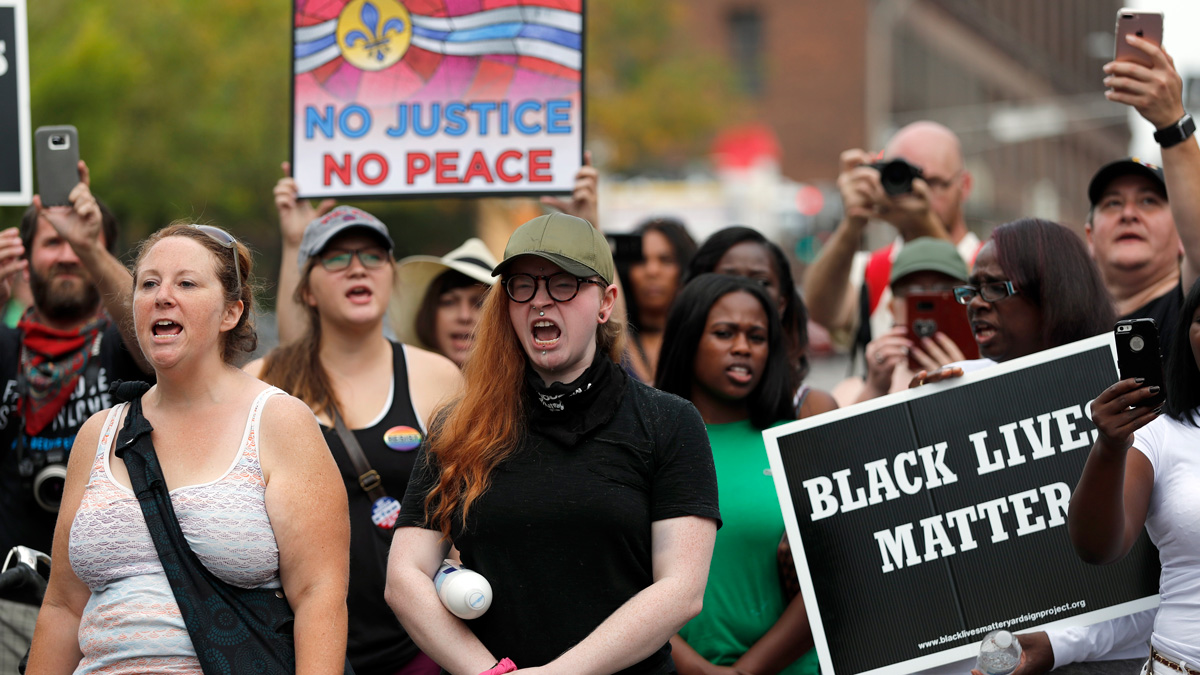Demonstrators protest outside the St. Louis Police Department headquarters in response to a not guilty verdict in the trial of former St. Louis police officer Jason Stockley Sunday, Sept. 17, 2017, in St. Louis. Stockley was acquitted on Friday in the 2011 killing of a black man following a high-speed chase. (AP Photo/Jeff Roberson)