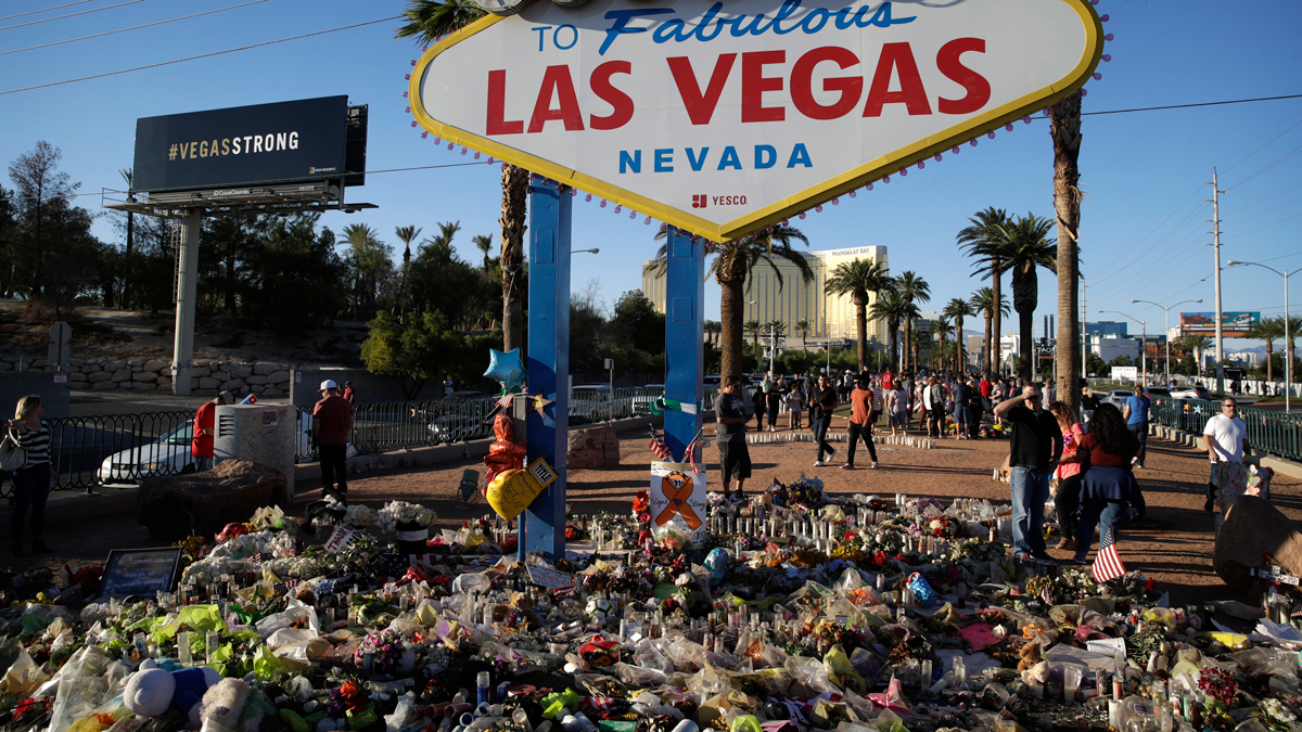 Flowers, candles and other items surround the famous Las Vegas sign at a makeshift memorial for victims of a mass shooting Monday, Oct. 9, 2017, in Las Vegas. Stephen Paddock opened fire on an outdoor country music concert killing dozens and injuring hundreds.