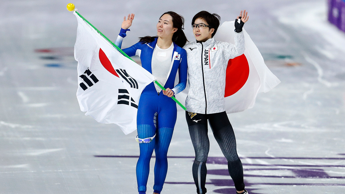 Gold medalist Japan's Nao Kodaira, right, and silver medalist Lee Sang-hwa of South Korea celebrate after the women's 500 meters speedskating race at the Gangneung Oval at the 2018 Winter Olympics in Gangneung, South Korea, Sunday, Feb. 18, 2018.