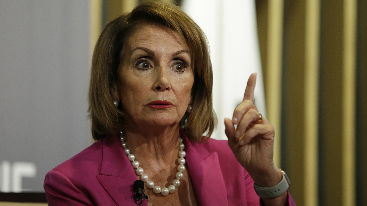 House Minority Leader Nancy Pelosi faced insults as she entered a campaign event for the Democratic party in Coral Gables, Fla., on Wednesday.