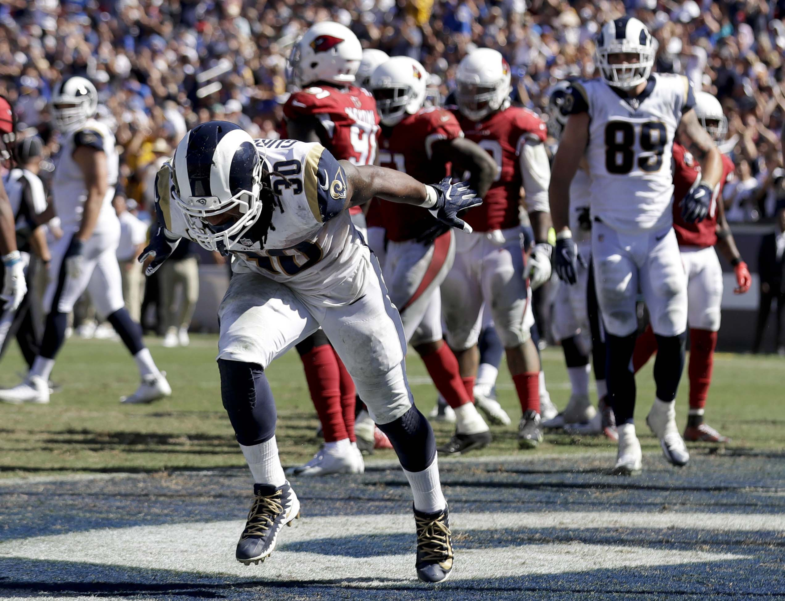 Los Angeles Rams running back Todd Gurley celebrates after scoring during the second half of an NFL football game against the Arizona Cardinals Sunday, Sept. 16, 2018, in Los Angeles. (AP Photo/Marcio Jose Sanchez)