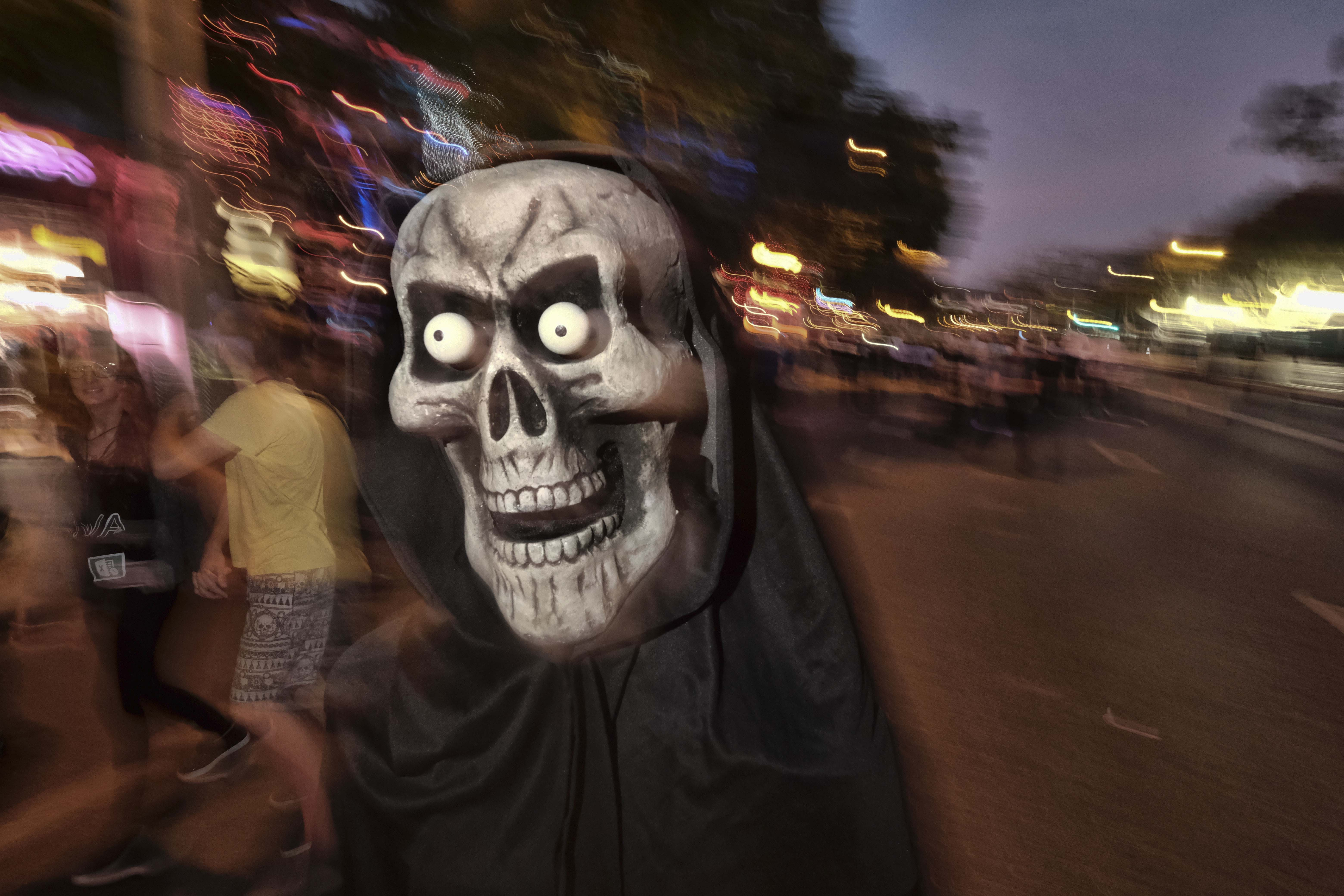 A person in costume joins parade goers down Santa Monica Blvd. in West Hollywood, Calif., during the West Hollywood Carnaval and Halloween Parade on Wed. Oct. 31, 2018. (AP Photo/Richard Vogel)