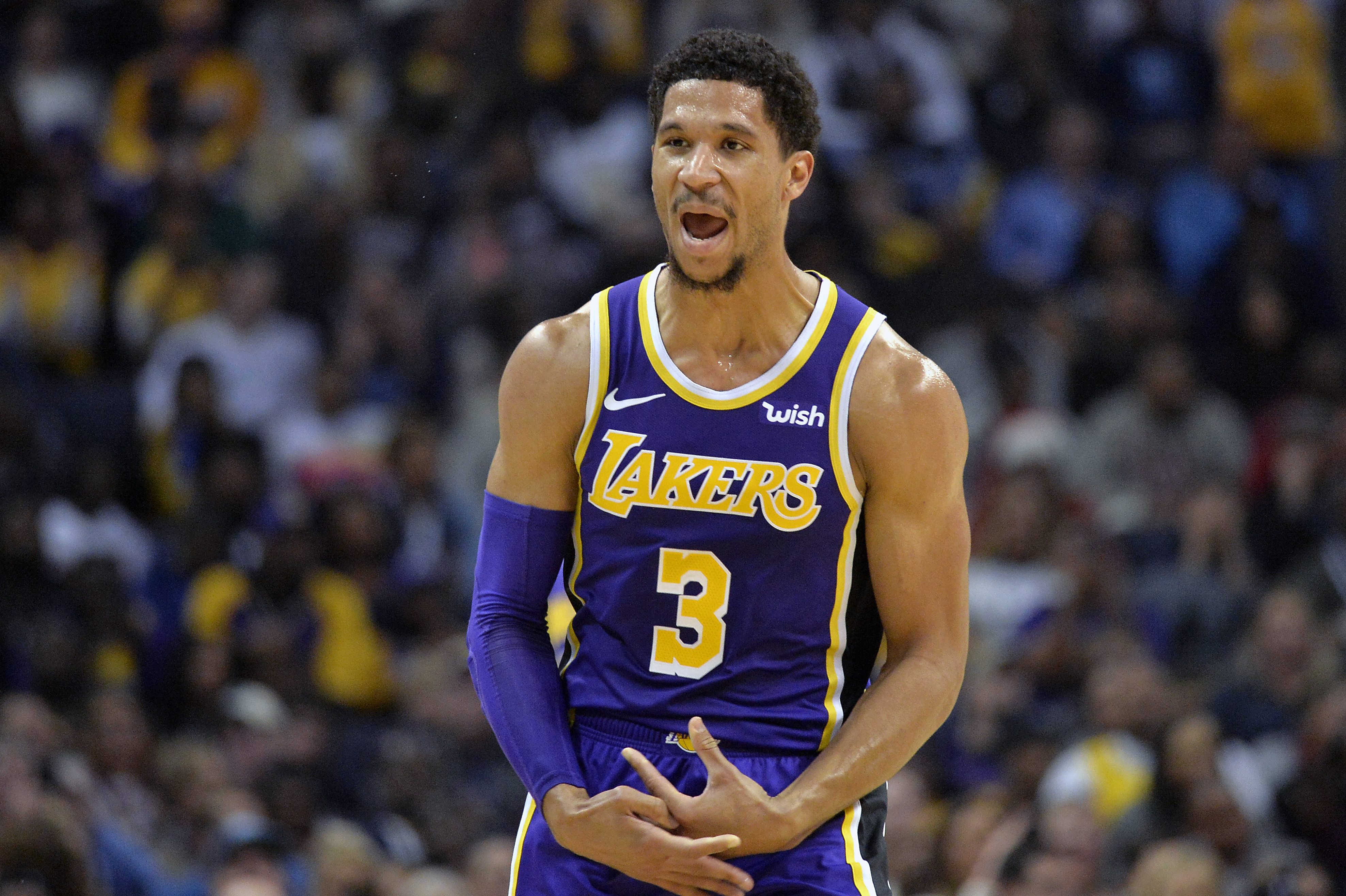 Los Angeles Lakers guard Josh Hart (3) reacts after scoring a 3-point shot in the first half of an NBA basketball game against the Memphis Grizzlies on Saturday, Dec. 8, 2018, in Memphis, Tenn. (AP Photo/Brandon Dill)