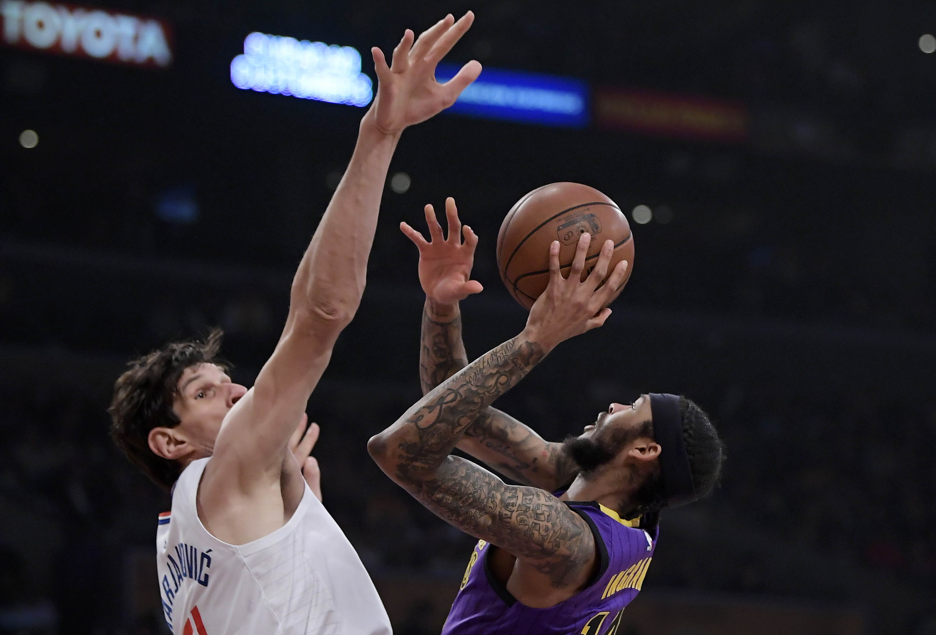 Los Angeles Lakers forward Brandon Ingram, right, shoots as Los Angeles Clippers center Boban Marjanovic defends during the first half of an NBA basketball game Friday, Dec. 28, 2018, in Los Angeles. (AP Photo/Mark J. Terrill)