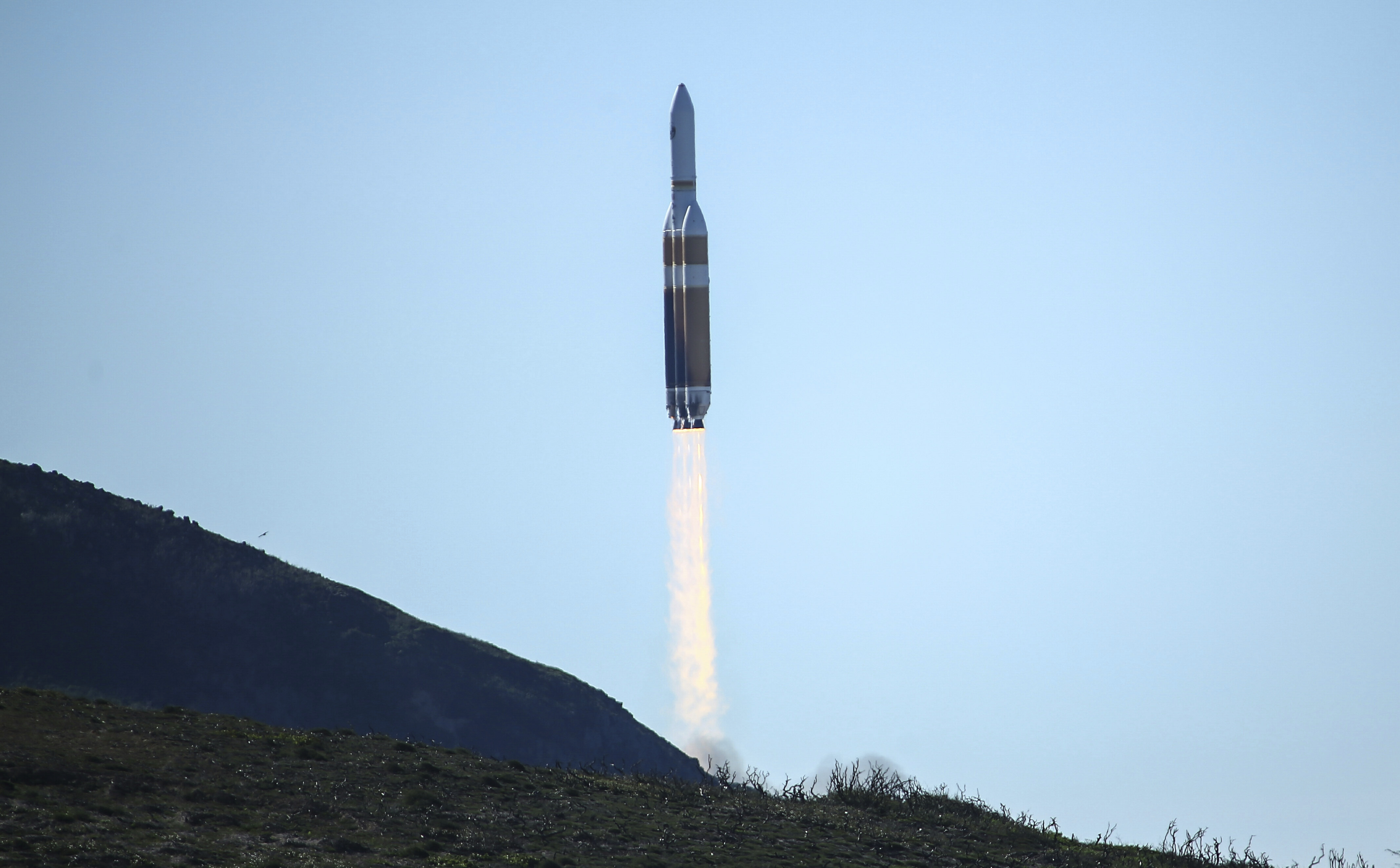A powerful Delta 4 Heavy rocket carrying a U.S. spy satellite lifts off from Vandenberg Air Force Base in Calif., Saturday, Jan. 19, 2019. The rocket propelled the National Reconnaissance Office satellite at 11:10 a.m. Pacific time, arcing over the Pacific Ocean west of Los Angeles as it headed toward space. The United Launch Alliance Delta 4 Heavy is made up of 3 rocket cores strapped together producing almost 2.2 million pounds of thrust at lift-off. (AP Photo/Matt Hartman)