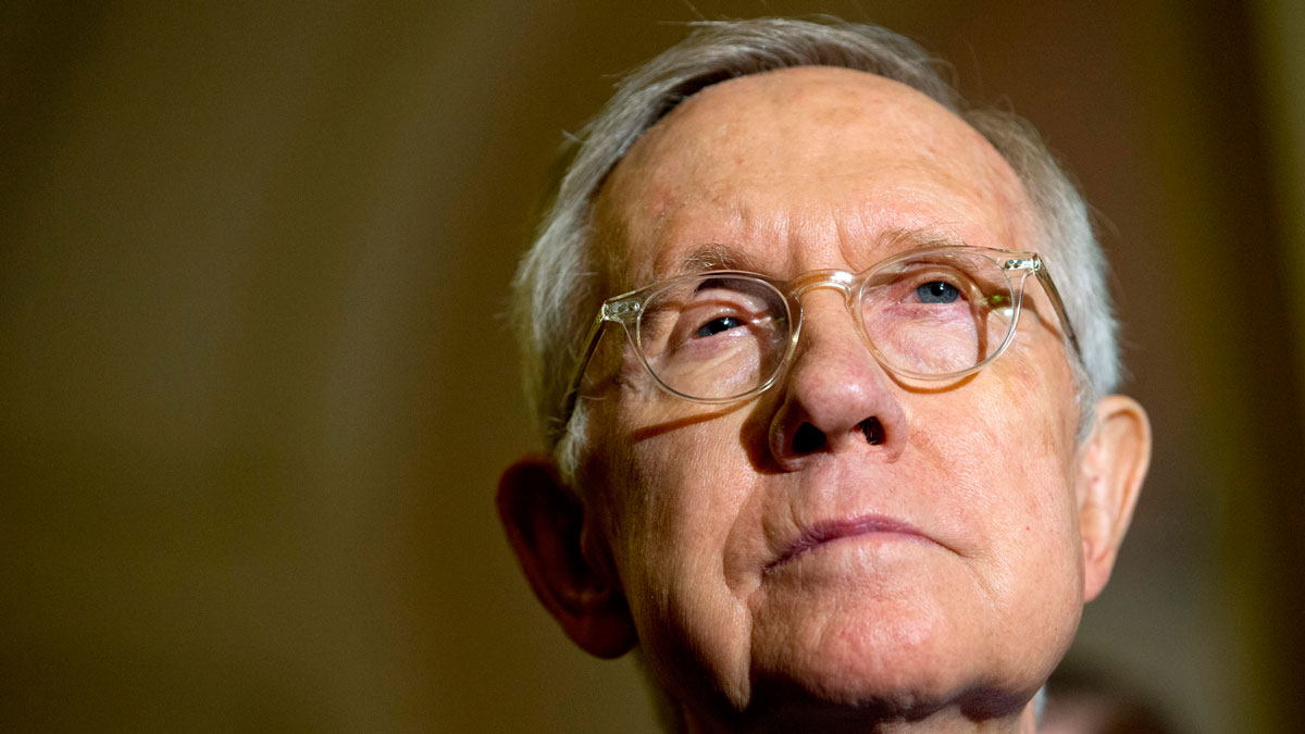 FILE - In this Tuesday, Oct. 6, 2015 file photo Senate Minority Leader Harry Reid of Nev. listens during a news conference on Capitol Hill in Washington.