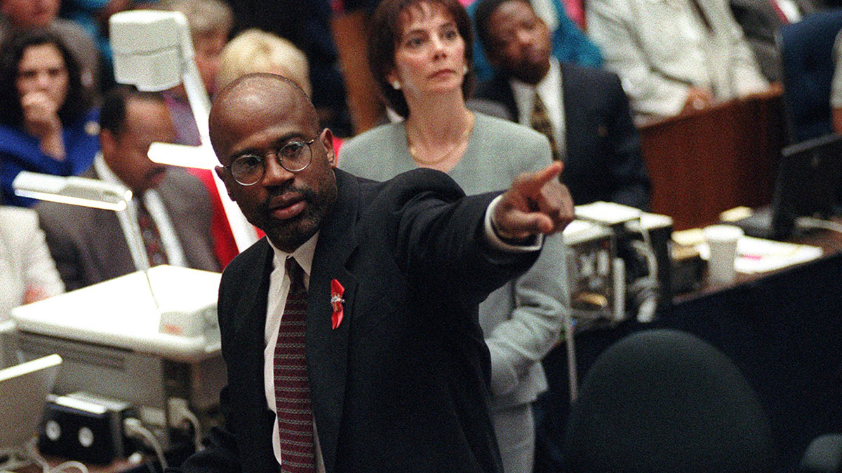 In this Sept. 29, 1995, file photo, prosecutor Christopher Darden points at a chart during his closing arguments as Marcia Clark looks on in a Los Angeles courtroom during the O.J. Simpson double-murder trial.