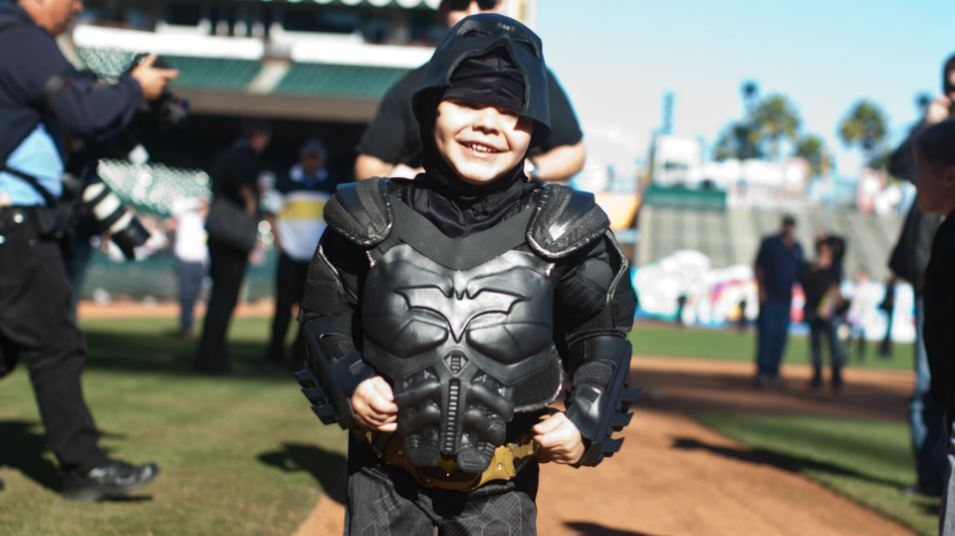 Leukemia survivor Miles, 5, dressed as BatKid, runs the bases as part of a Make-A-Wish foundation fulfillment at AT&T Park November 15, 2013 in San Francisco. The Make-A-Wish Greater Bay Area foundation turned the city into Gotham City for Miles by creating a day-long event bringing his wish to be BatKid to life. (Photo by Ramin Talaie/Getty Images)