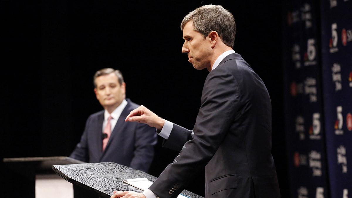 Democratic U.S. Rep. Beto O'Rourke makes a point as Republican Sen. Ted Cruz waits his turn during a debate at McFarlin Auditorium at SMU on Sept. 21, 2018, in Dallas, Texas.