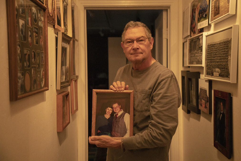 Widower Nowell Wisch holds a photo of his wife Diana Barliant, who died from an opiate overdose.