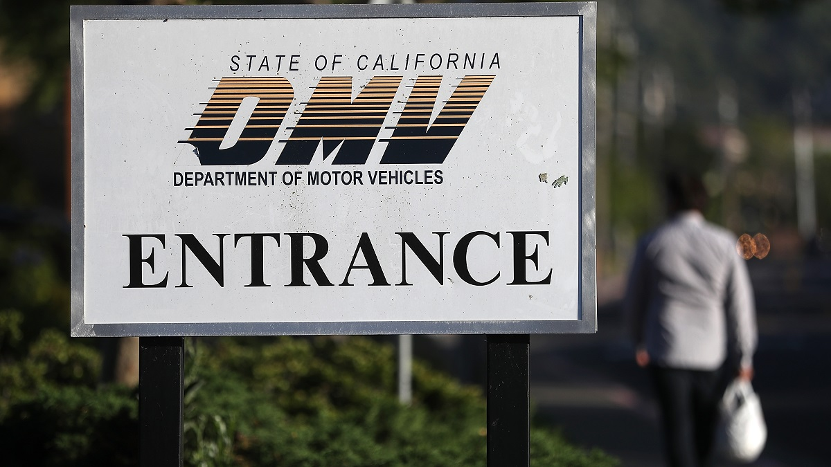 A sign is posted in front of a California Department of Motor Vehicles (DMV) office on May 9, 2017 in Corte Madera, California. The California Department of Motor Vehicles is being accused in a federal lawsuit of violating voter federal