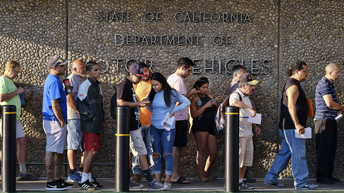 People line up before the doors open at the California Department of Motor Vehicles office in the Van Nuys section of Los Angeles, Aug. 7, 2018.