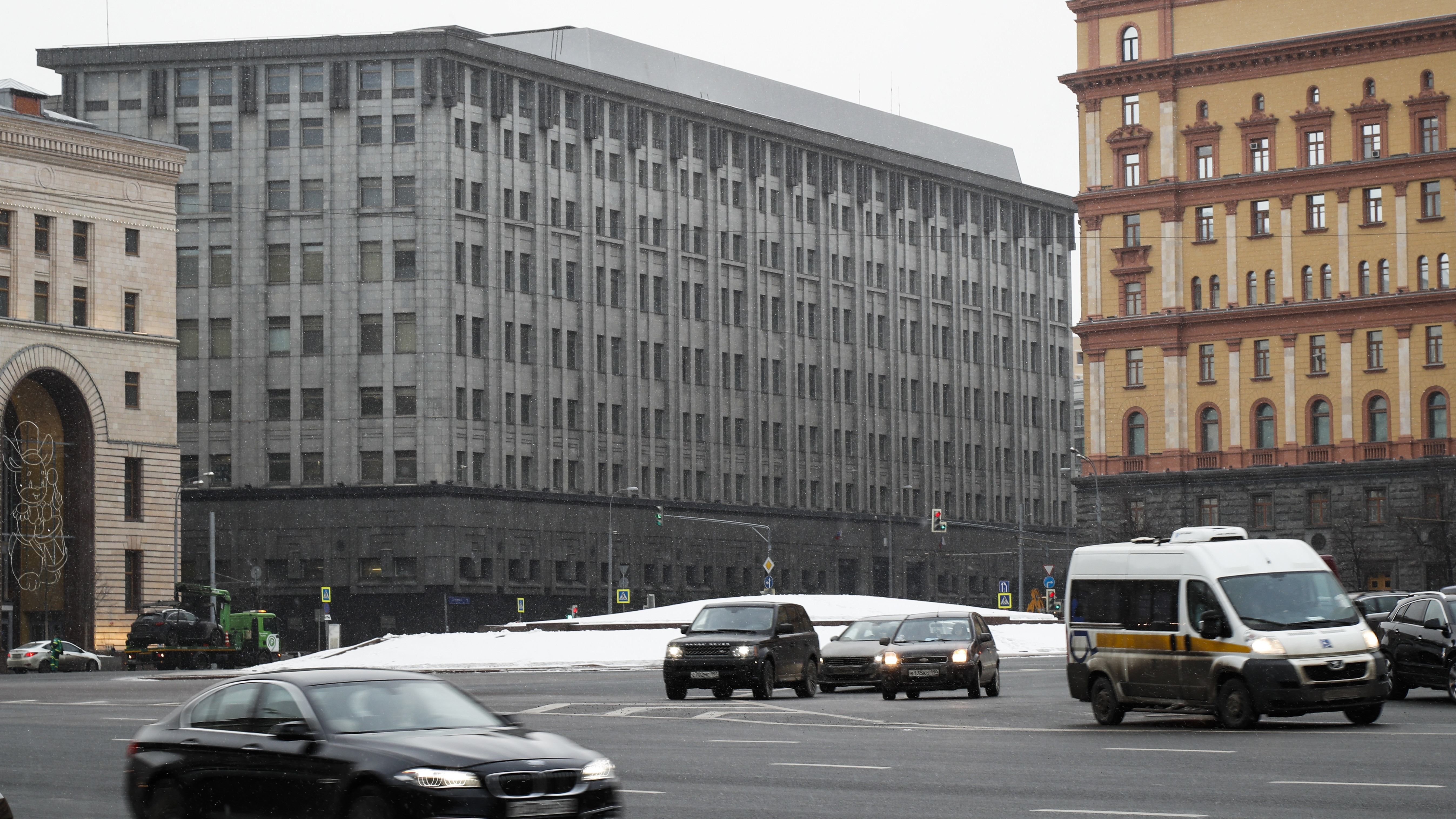 FILE - In this Friday, Dec. 30, 2016 file cars pass the FSB headquarters in downtown Moscow, Russia.