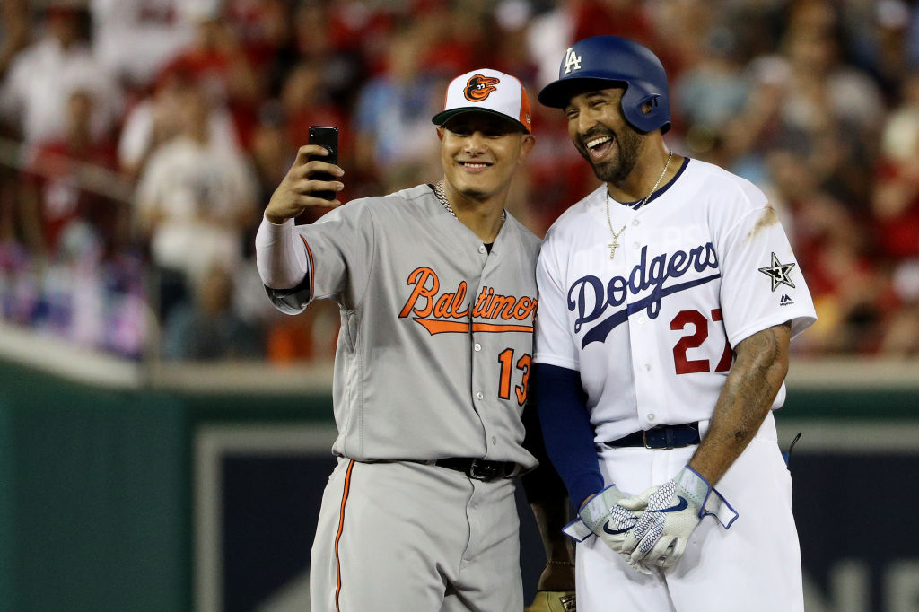 Manny Machado #13 of the Baltimore Orioles and the American League and Matt Kemp #27 of the Los Angeles Dodgers and the National League pose for a selfie in the second inning during the 89th MLB All-Star Game, presented by Mastercard at Nationals Park on July 17, 2018 in Washington, DC. (Photo by Patrick Smith/Getty Images)