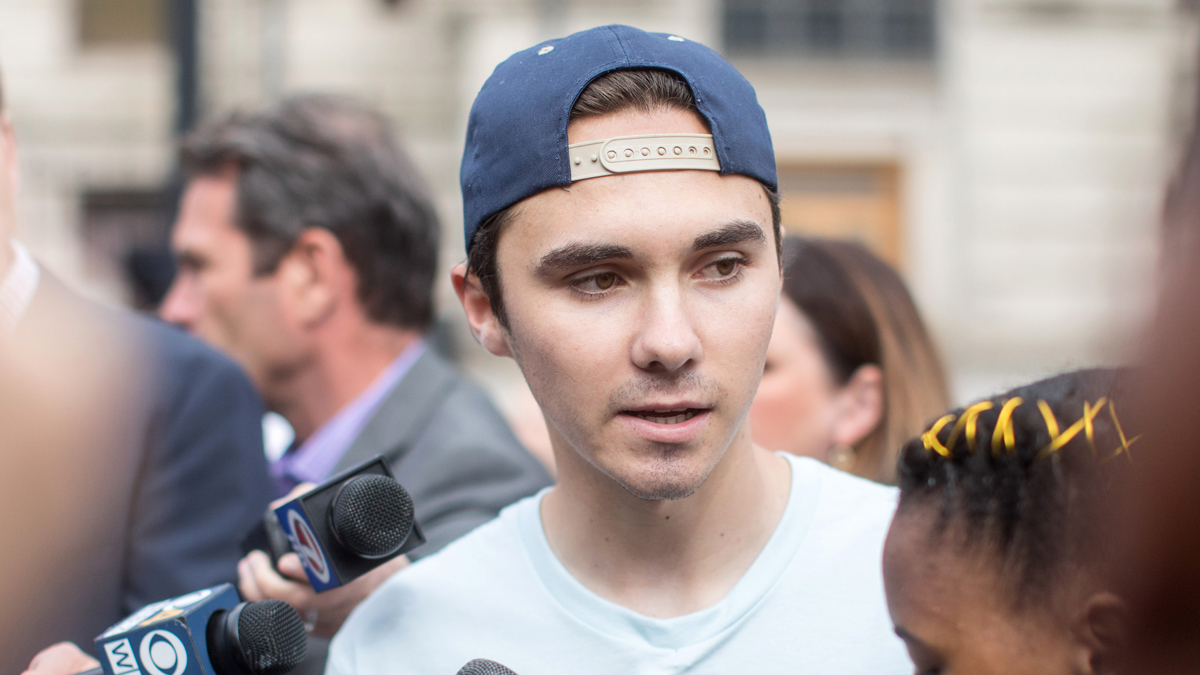 David Hogg, Parkland shooting survivor and activist givess an interview before the kick off of the 50 Miles More walk against gun violence which will end with a protest at Smith and Wesson Firearms factory on August 23, 2018 in Worcester, Massachusetts.