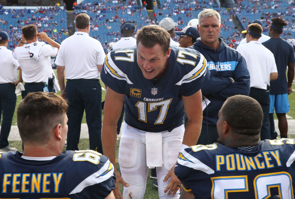BUFFALO, NY - SEPTEMBER 16: Philip Rivers #17 of the Los Angeles Chargers gives encouragement to Dan Feeney #66 and Mike Pouncey #53 in the closing moments of the their NFL game against the Buffalo Bills at New Era Field on September 16, 2018 in Buffalo, New York. (Photo by Tom Szczerbowski/Getty Images)
