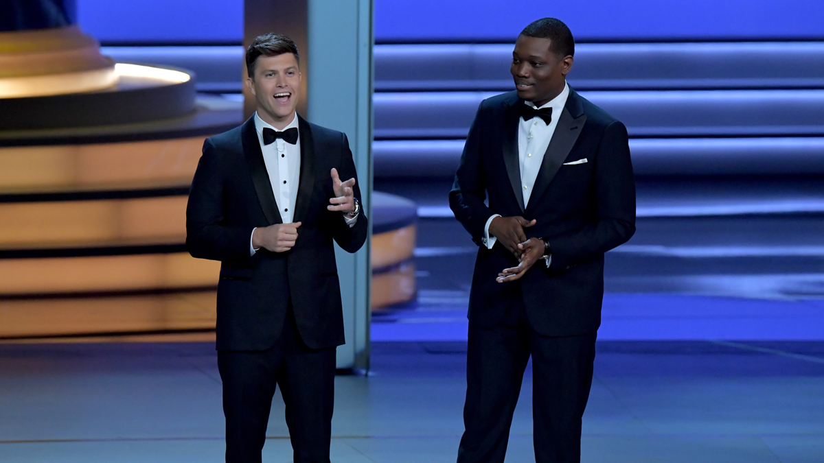 Colin Jost (L) and Michael Che onstage during the 70th Emmy Awards at Microsoft Theater on Sept.17, 2018, in Los Angeles, California.