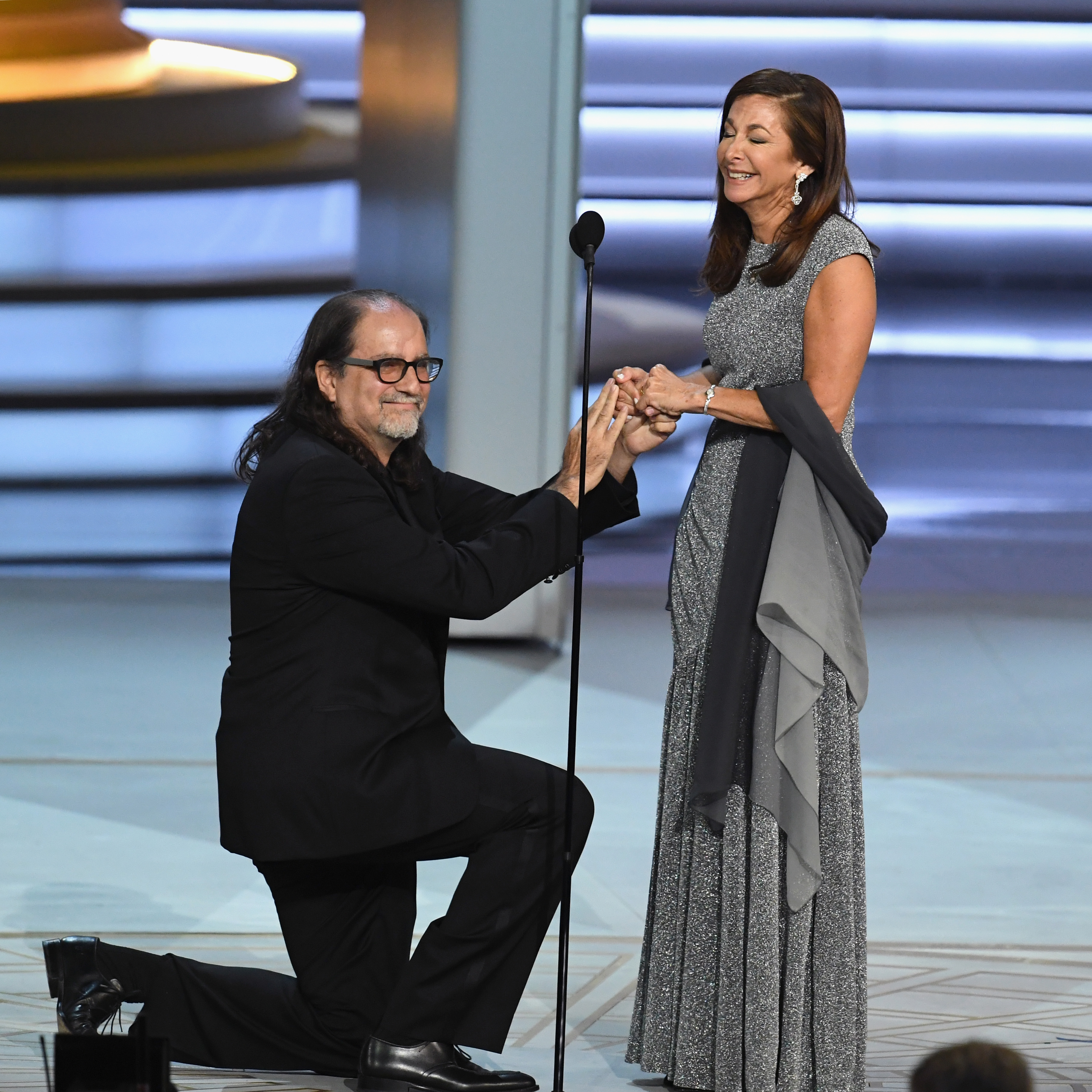 Glenn Weiss (L), winner of the Outstanding Directing for a Variety Special award for 'The Oscars,' proposes marriage to Jan Svendsen during the 70th Emmy Awards at Microsoft Theater on September 17, 2018 in Los Angeles, California. (Photo by Kevin Winter/Getty Images)