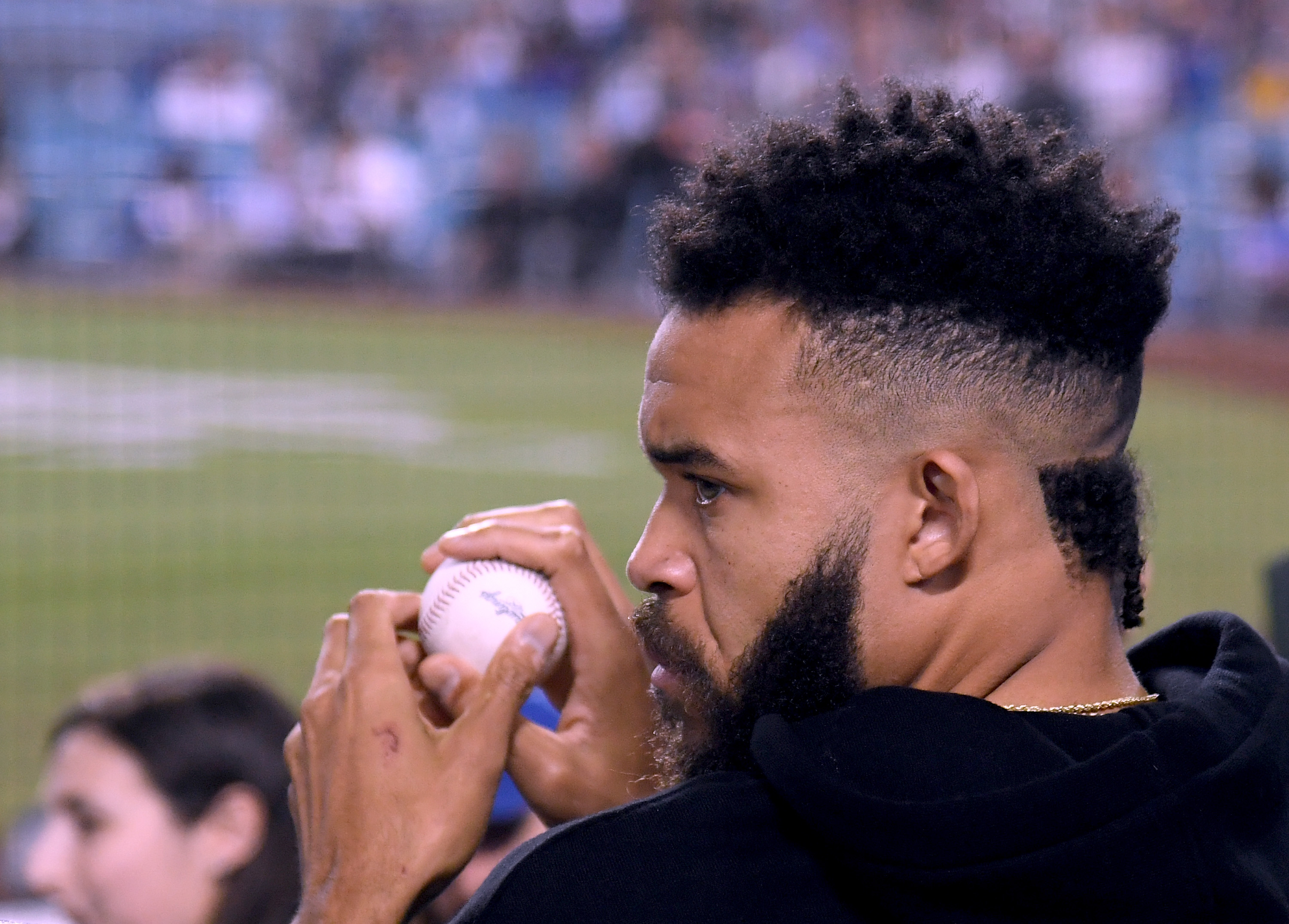 New Los Angeles Laker, JaVale McGee, takes in the game between the Colorado Rockies and the Los Angeles Dodgers at Dodger Stadium on September 19, 2018 in Los Angeles, California. (Photo by Harry How/Getty Images)