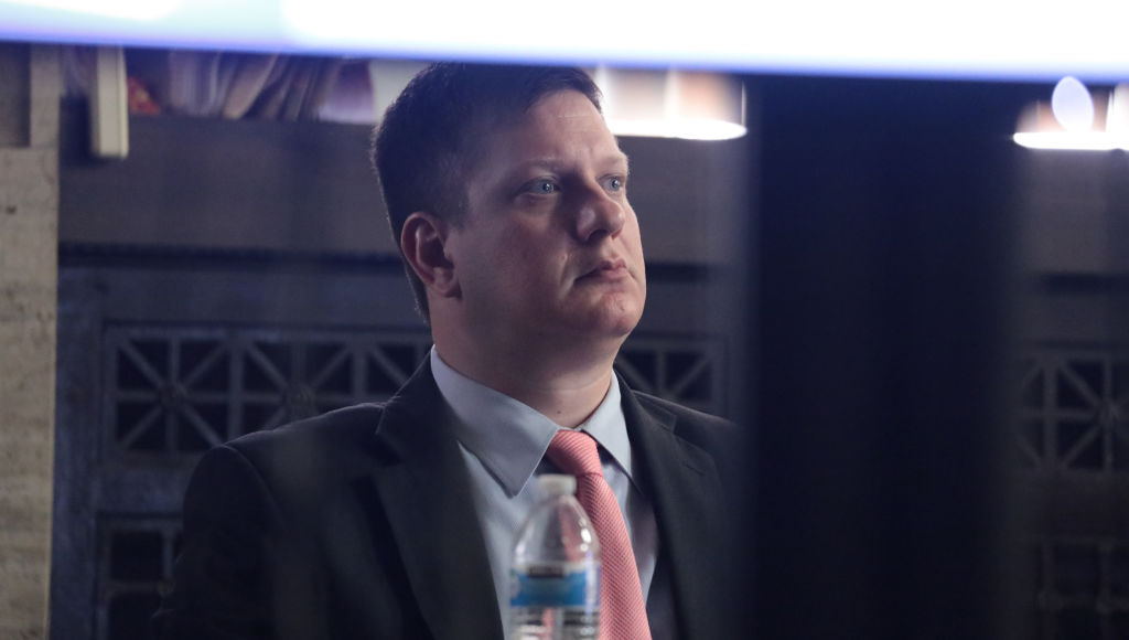 Chicago police Officer Jason Van Dyke listens during the presentation of his defense on murder charges at the Leighton Criminal Court Building September 24, 2018, in Chicago, Illinois. Van Dyke is charged with shooting and killing black 17-year-old Laquan McDonald, who was walking away from police down a street holding a knife four years ago.