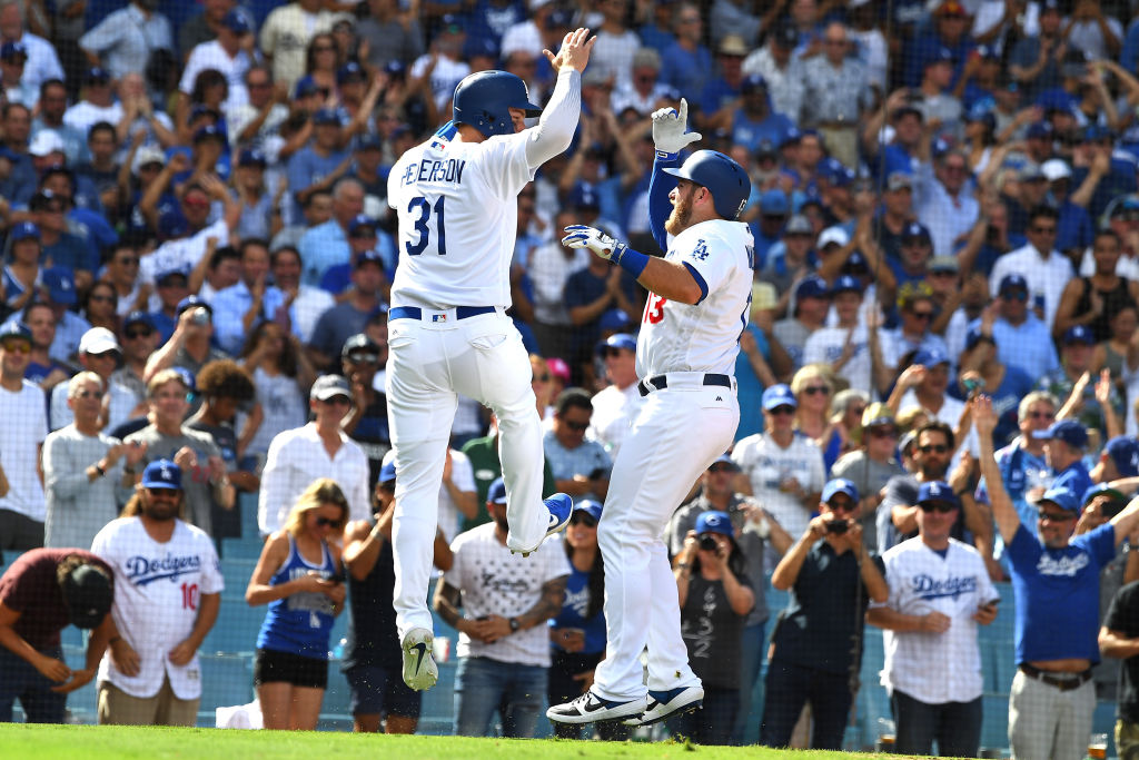 Max Muncy #13 celebrates with Joc Pederson #31 of the Los Angeles Dodgers after hitting a two run home run in the sixth inning of the game against the Colorado Rockies at Dodger Stadium on October 1, 2018 in Los Angeles, California. (Photo by Jayne Kamin-Oncea/Getty Images)