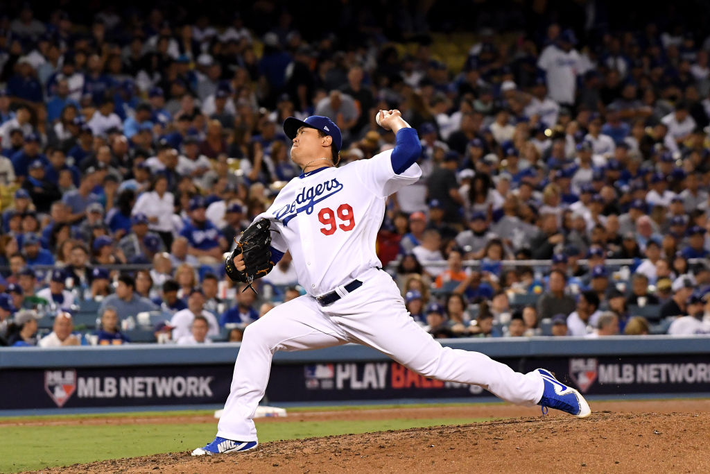 LOS ANGELES, CA - OCTOBER 04: Hyun-Jin Ryu #99 of the Los Angeles Dodgers delivers the pitch during the sixth inning against the Atlanta Braves during Game One of the National League Division Series at Dodger Stadium on October 4, 2018 in Los Angeles, California. (Photo by Harry How/Getty Images)