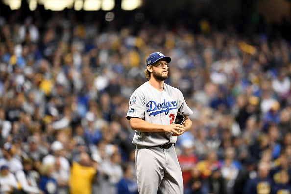 Clayton Kershaw #22 of the Los Angeles Dodgers looks on against the Milwaukee Brewers during the third inning in Game One of the National League Championship Series at Miller Park on October 12, 2018 in Milwaukee, Wisconsin. (Photo by Stacy Revere/Getty Images)