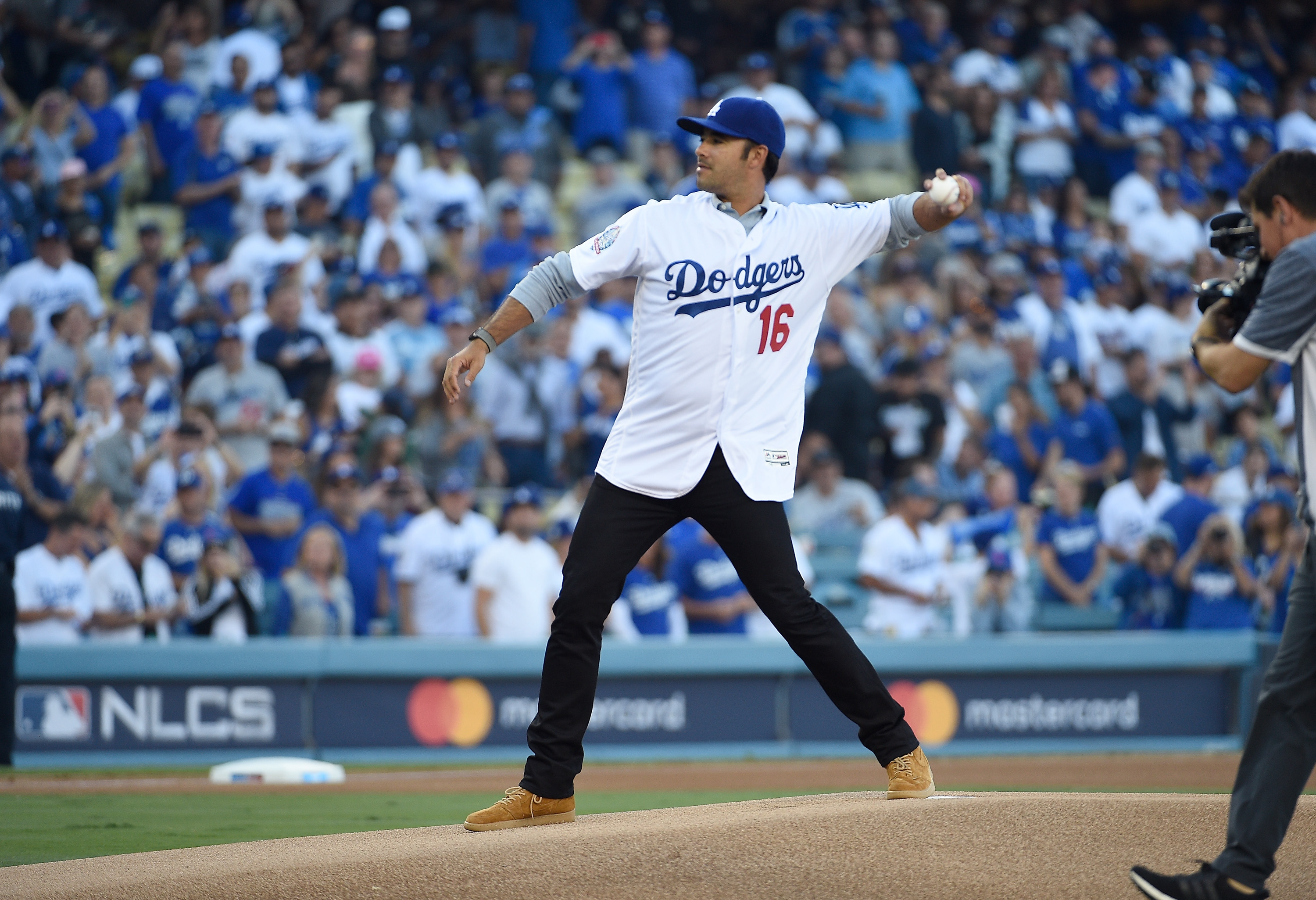 Former Los Angeles Dodgers player Andre Ethier throws out the ceremonial first pitch prior to Game 3 of the National League Championship Series between the Milwaukee Brewers and the Los Angeles Dodgers at Dodger Stadium on October 15, 2018 in Los Angeles, California. (Photo by Kevork Djansezian/Getty Images)