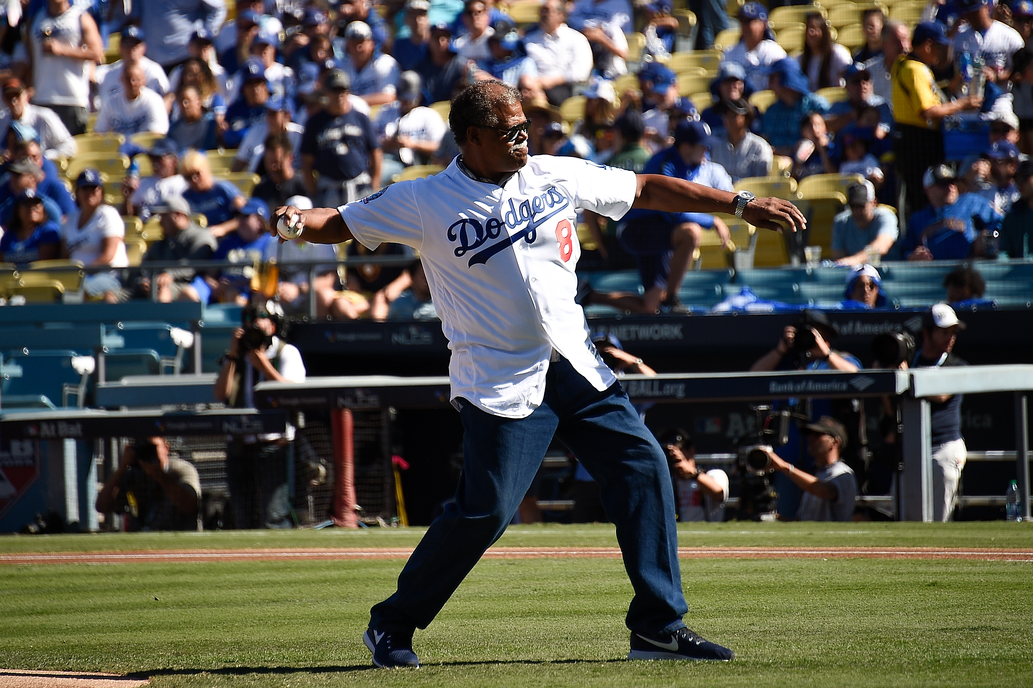 Former Los Angeles Dodger Reggie Smith throws out the first pitch prior to Game Five of the National League Championship Series between the Los Angeles Dodgers and the Milwaukee Brewers at Dodger Stadium on October 17, 2018 in Los Angeles, California. (Photo by Kevork Djansezian/Getty Images)