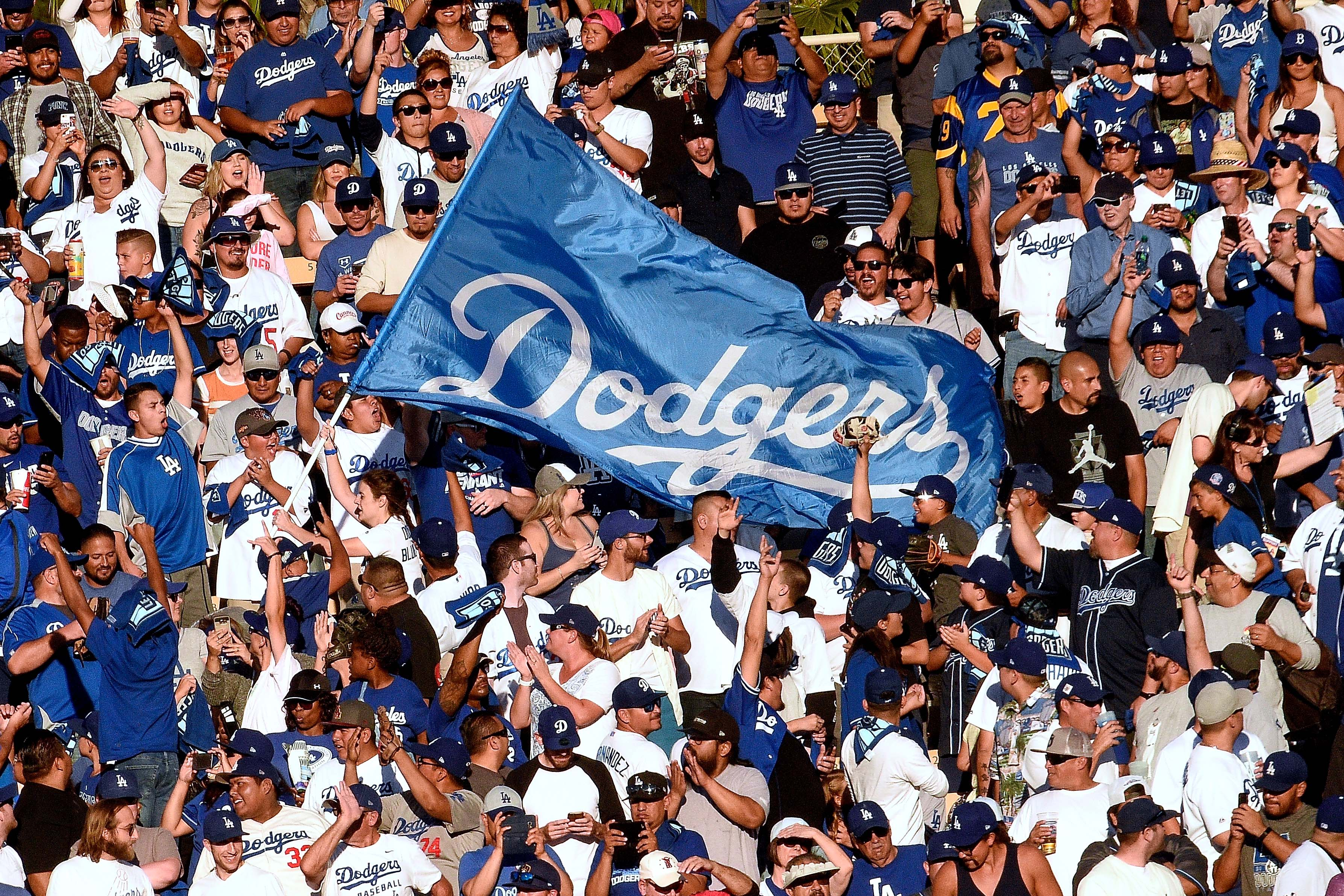 LOS ANGELES, CA - OCTOBER 17: Los Angeles Dodgers fans cheer during the eighth inning against the Milwaukee Brewers in Game Five of the National League Championship Series at Dodger Stadium on October 17, 2018 in Los Angeles, California. (Photo by Kevork Djansezian/Getty Images)