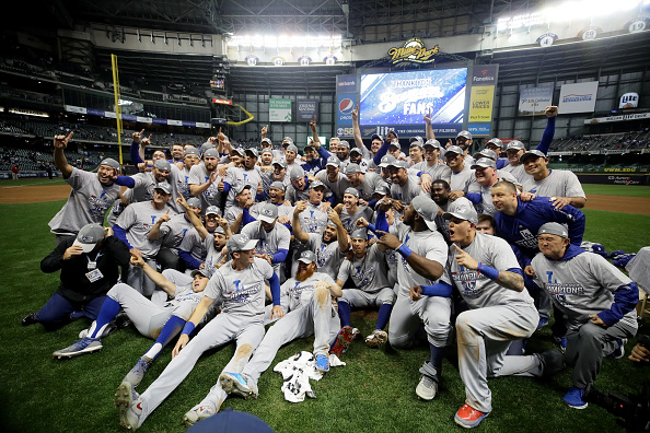 The Los Angeles Dodgers celebrate after defeating the Milwaukee Brewers in Game Seven to win the National League Championship Series at Miller Park on October 20, 2018 in Milwaukee, Wisconsin. (Photo by Jonathan Daniel/Getty Images)