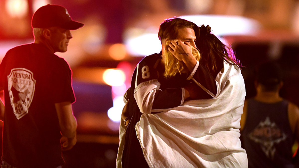 Witnesses console each other near the Borderline Bar on Nov. 8, 2018, in Thousand Oaks, California.