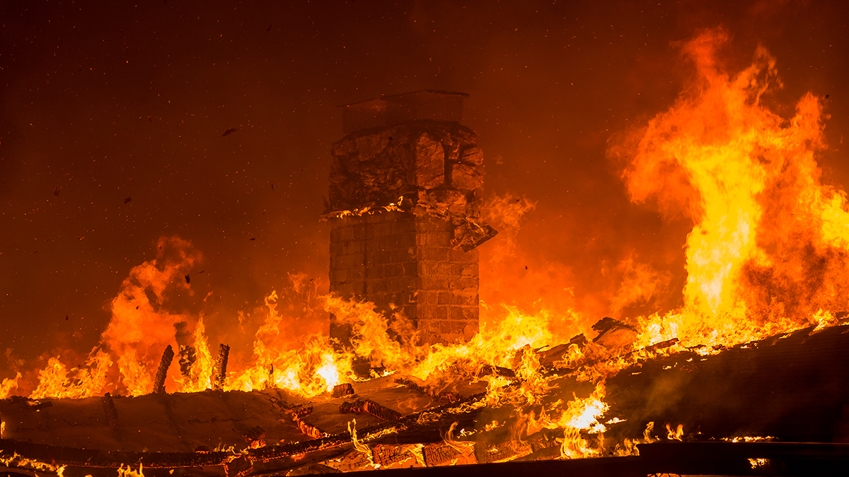 A house burns during the Woolsey Fire on November 9, 2018 in Malibu, California. After a experiencing a mass shooting, residents of Thousand Oaks are threatened by the ignition of two nearby dangerous wildfires, including the Woolsey Fire which has reached the Pacific Coast at Malibu. (Photo by David McNew/Getty Images)