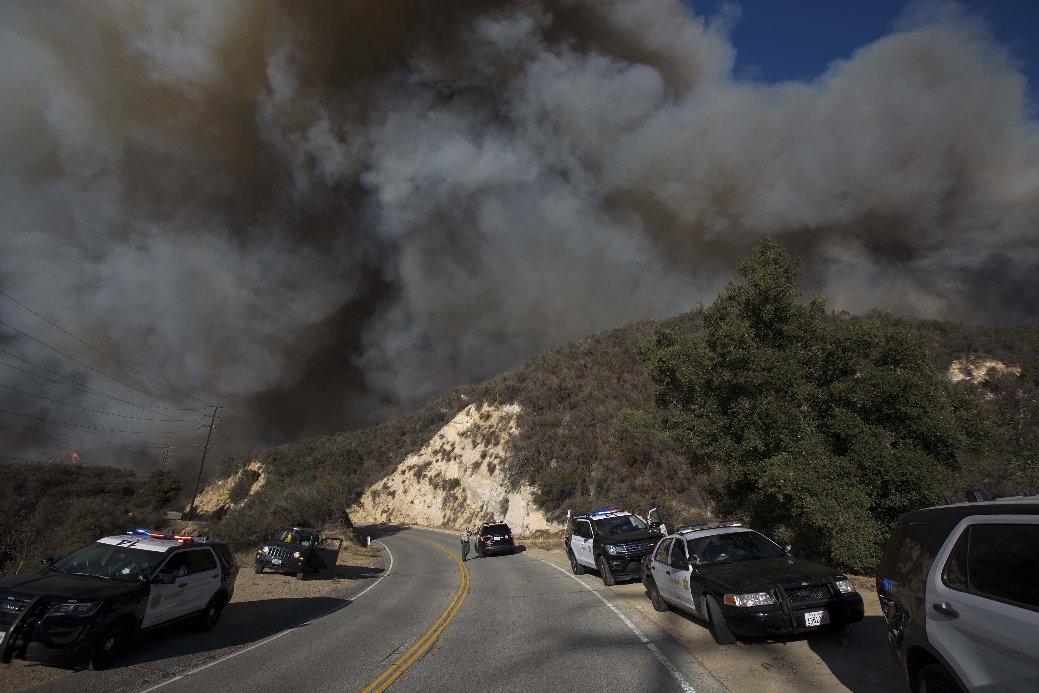 MALIBU, CA - NOVEMBER 09: Wind-driven flames move across Malibu Creek State Park during the Woolsey Fire on November 9, 2018 near Malibu, California. After a experiencing a mass shooting, residents of Thousand Oaks are threatened by the ignition of two nearby dangerous wildfires, including the Woolsey Fire which has reached the Pacific Coast at Malibu. (Photo by David McNew/Getty Images)