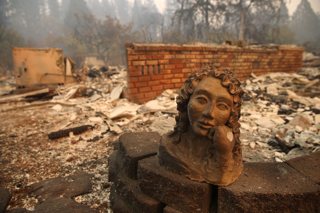 A statue remains in front of a home that was destroyed by the Camp Fire on November 10, 2018 in Paradise, California.