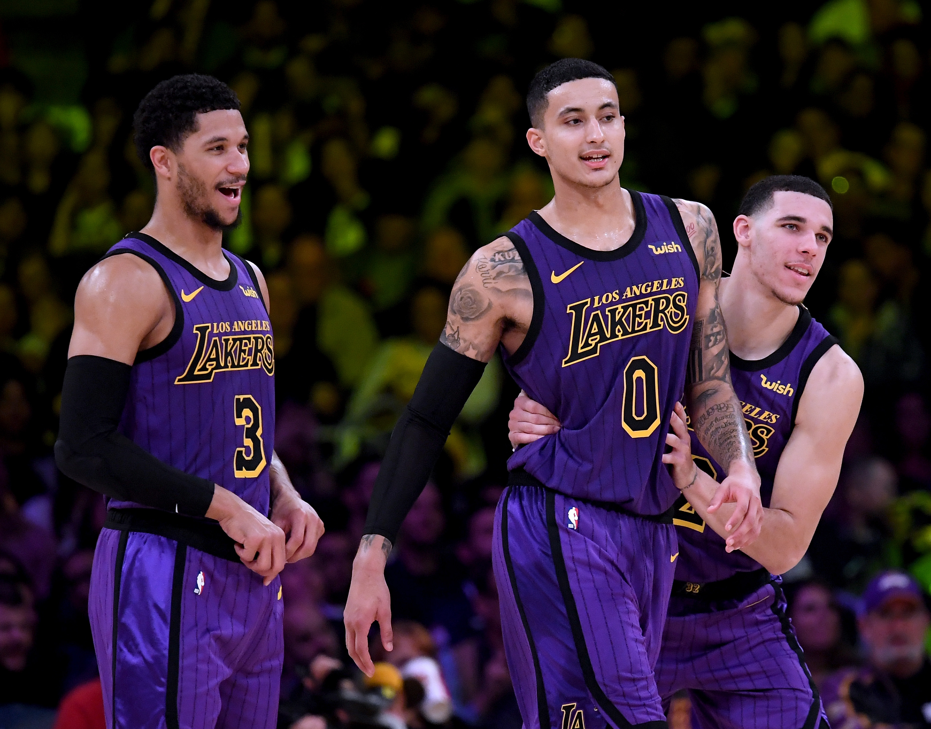 Lonzo Ball #2, Kyle Kuzma #0 and Josh Hart #3 of the Los Angeles Lakers joke during the game.
