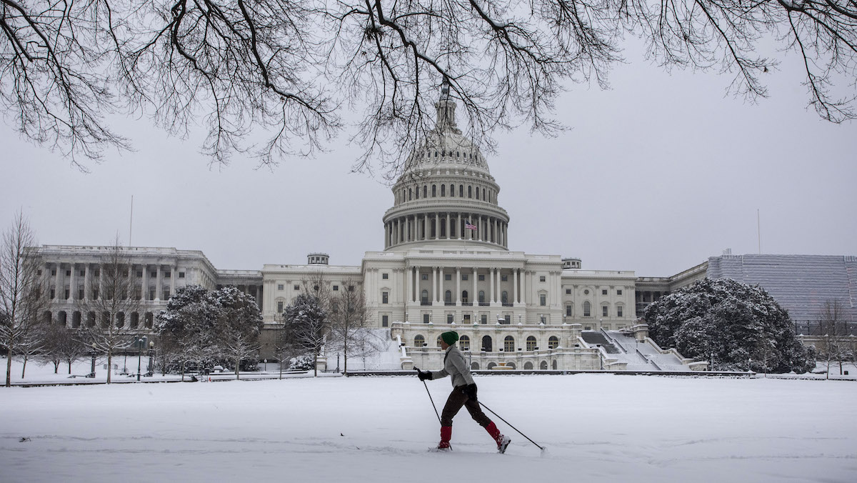 A woman cross country skis in front of the US Capitol as snow continues to fall in Washington, DC on January 13, 2019. - Washington area residents are waking up to a winter wonderland, and may need to shovel aside several inches of snow that fell overnight as a winter storm warning remains in effect until 6 p.m. Sunday and more snow is expected to fall. (Photo by Alex Edelman / AFP) (Photo credit should read ALEX EDELMAN/AFP/Getty Images)