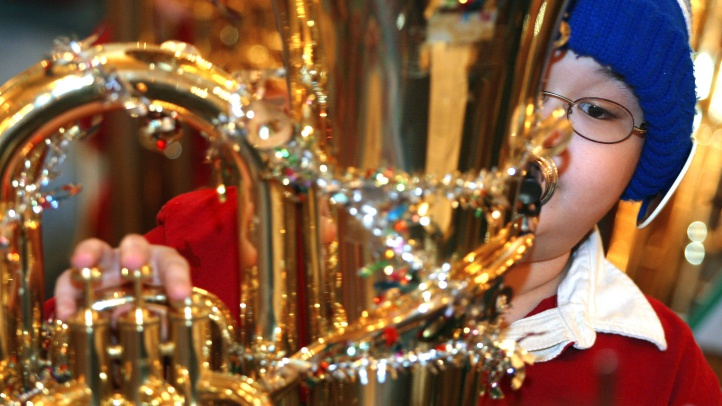 Hear one hundred tubas and baritone/euphonium players at Forest Lawn Hollywood Hills on the evening of Sunday, Dec. 2. (Photo by Tim Boyle/Getty Images)