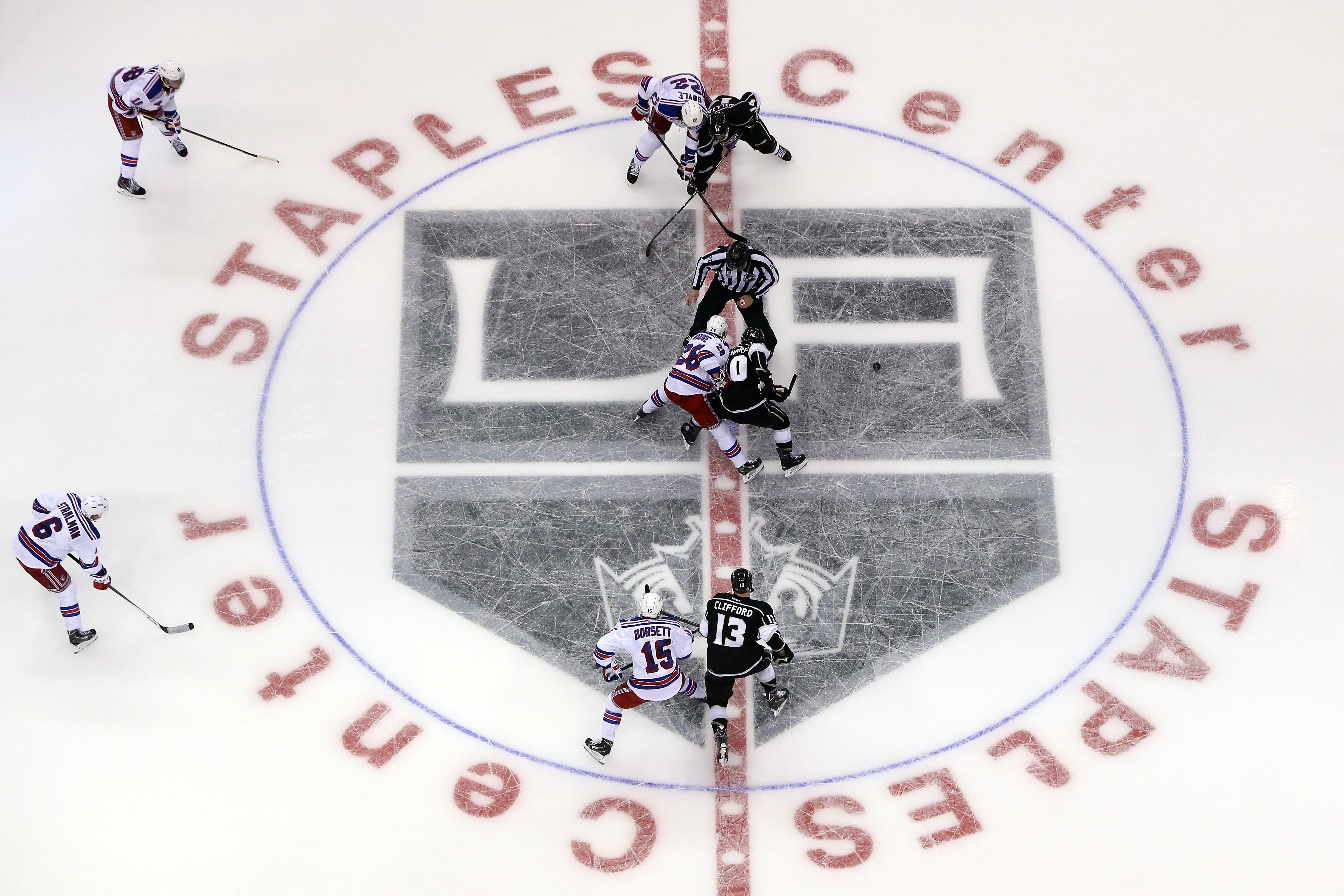 The New York Rangers face off against the Los Angeles Kings over the center ice logo against the Los Angeles Kings during Game One of the 2014 NHL Stanley Cup Final at the Staples Center on June 4, 2014 in Los Angeles, California. (Photo by Victor Decolongon/Getty Images)