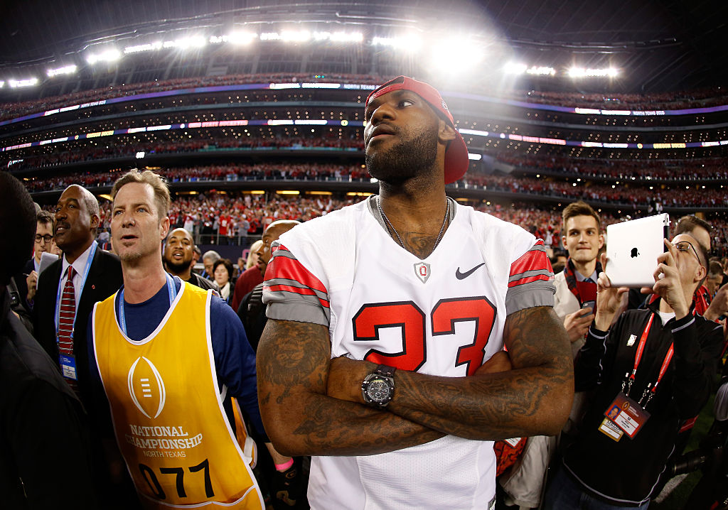 LeBron James wears an Ohio State jersey on the sidelines of the 2015 National Championship game. James trolled his teammate after OSU's victory over Michigan on Saturday.