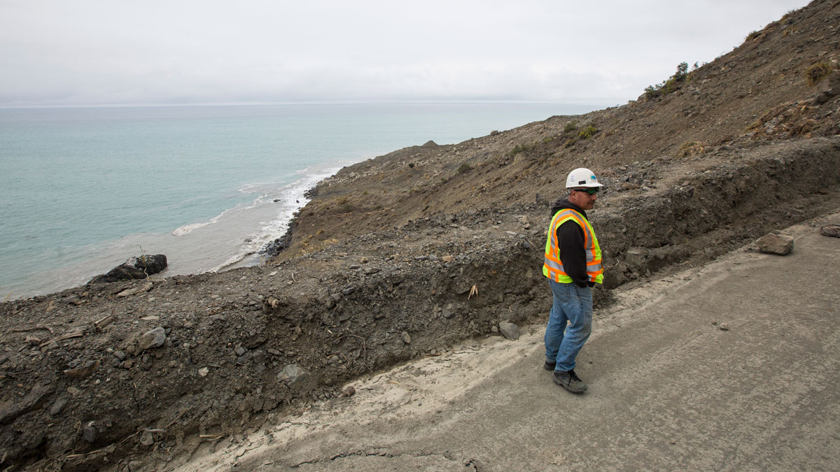 Caltrans resident engineer Rick Silva surveys Highway 1 where a landslide at Mud Creek cut off the road north of Ragged Point in with potential millions of pounds of rock and debris in Big Sur, California, on May 25, 2017.