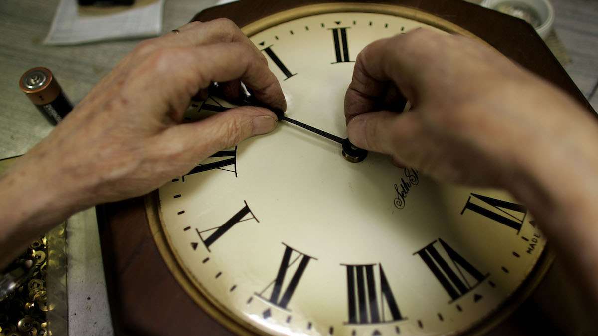 In this file photo, the time on a wall clock is changed manually ahead of Daylight Saving Time.