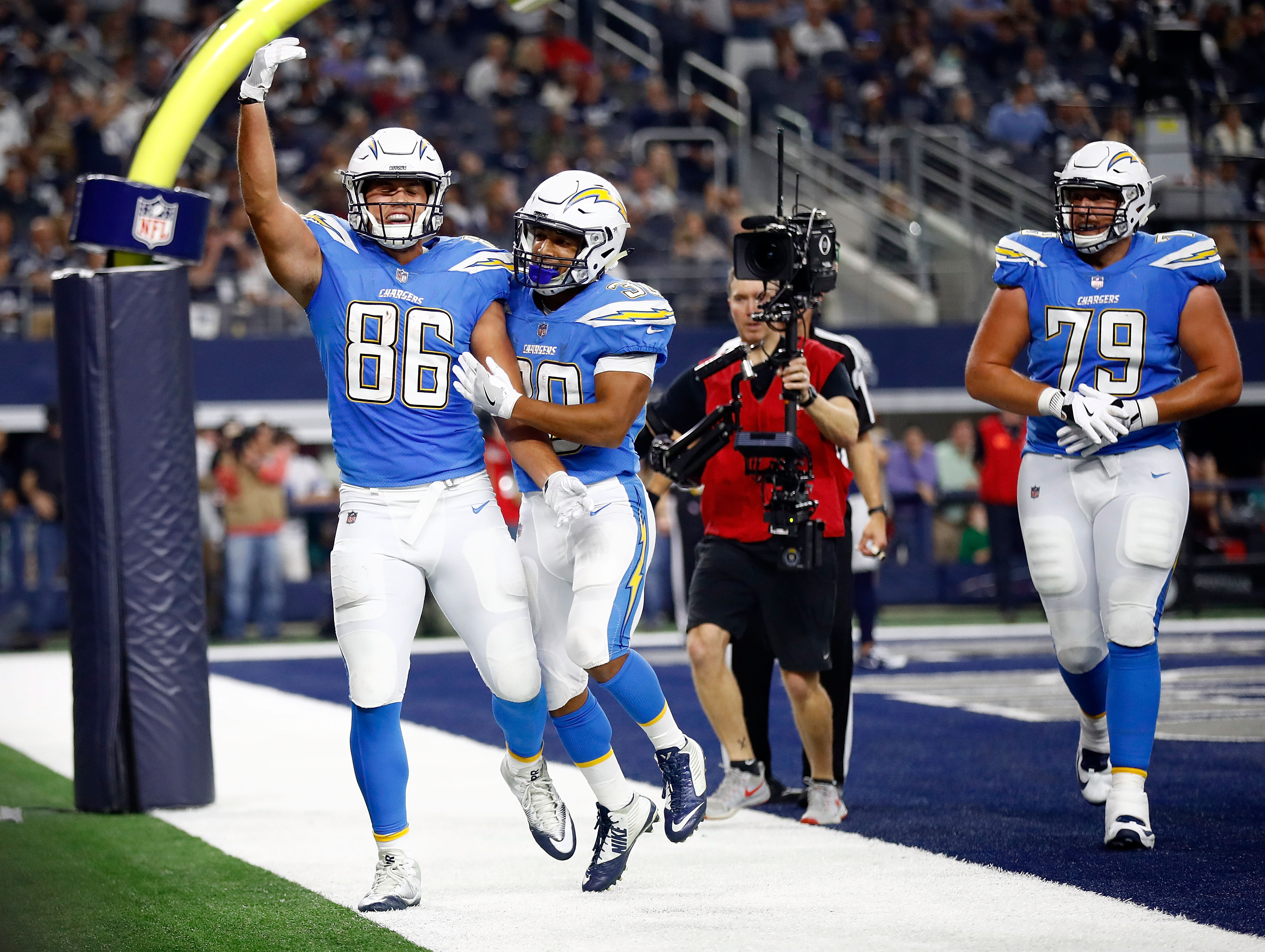 ARLINGTON, TX - NOVEMBER 23: Hunter Henry #86 of the Los Angeles Chargers and Austin Ekeler #30 of the Los Angeles Chargers celebrate a touchdown in the second half of a football game against the Dallas Cowboys at AT&T Stadium on November 23, 2017 in Arlington, Texas. (Photo by Wesley Hitt/Getty Images)