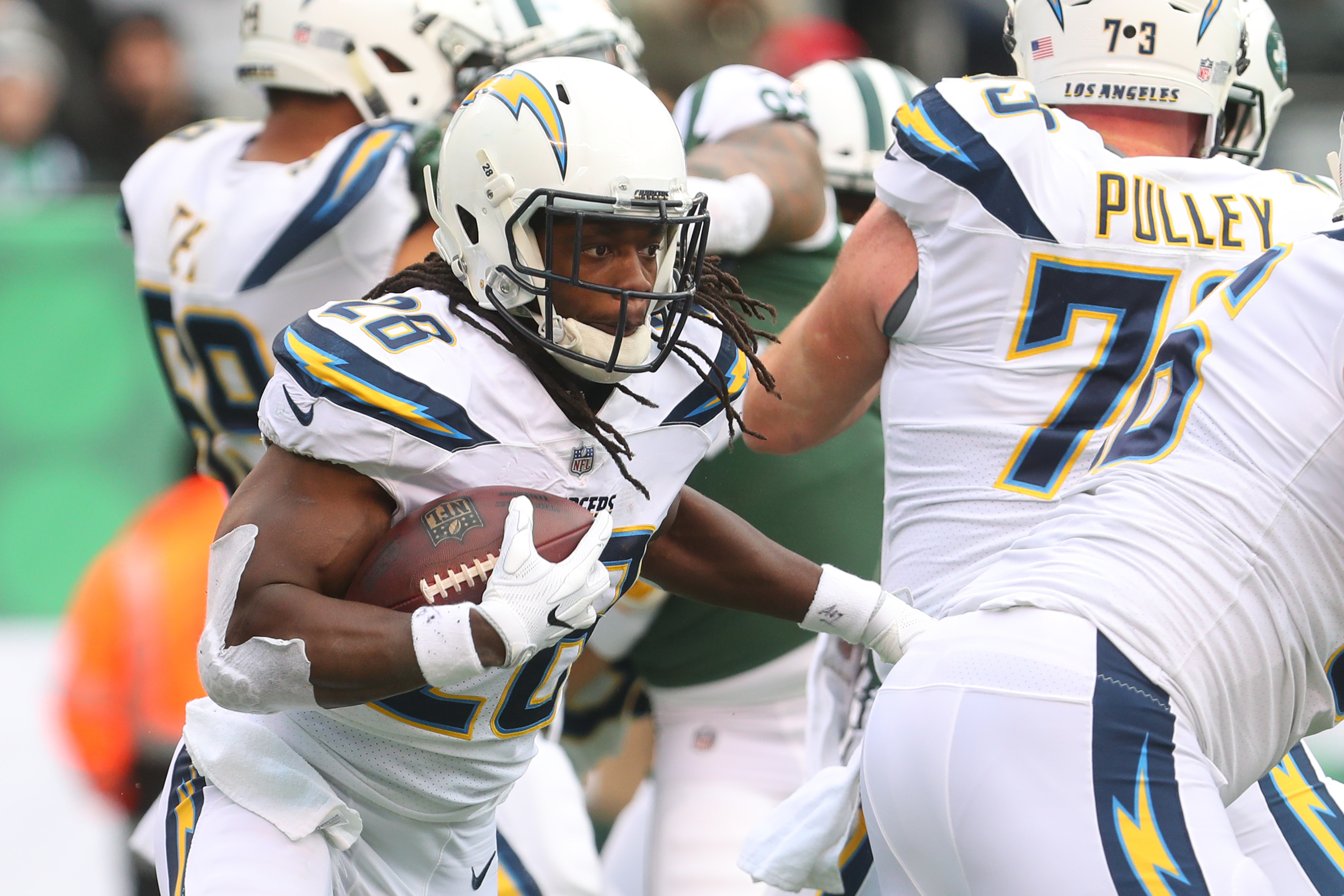 Melvin Gordon #28 of the Los Angeles Chargers runs the ball during the first half against the New York Jets in an NFL game at MetLife Stadium on December 24, 2017 in East Rutherford, New Jersey. (Photo by Ed Mulholland/Getty Images)