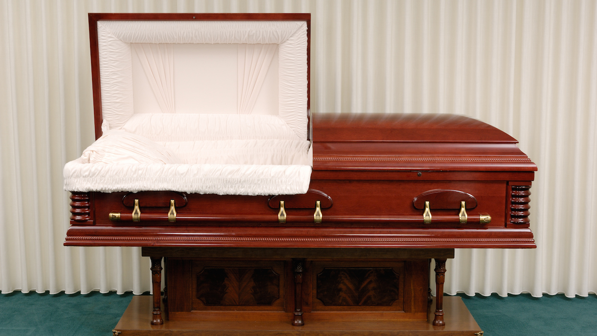 File- Wooden casket made of Cherry in a funeral home.