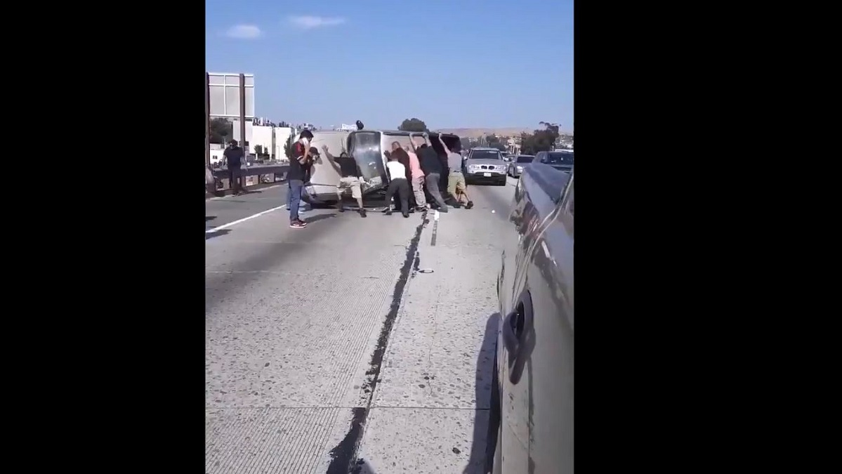 Good Samaritan Helps Pull 2 People to Safety, Flips Pickup on Freeway